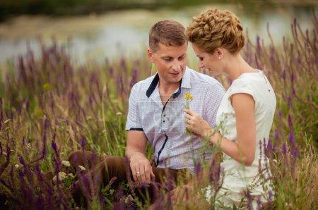 Loving wedding couple outdoors