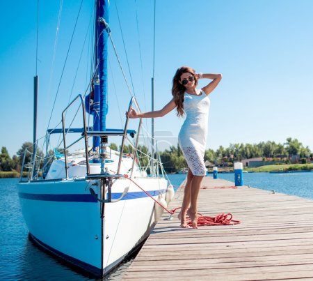 woman posing near  yacht
