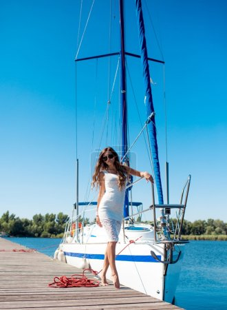woman posing near  yacht