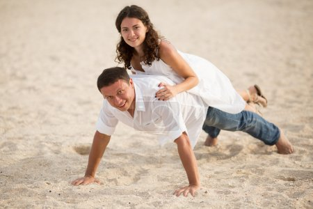 Photo for Happy couple portrait. Beautiful young couple  in love on beach. - Royalty Free Image