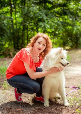 Woman with Samoyed dog breed in the park