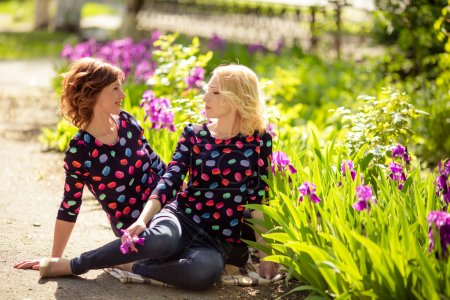 Mother and daughter in garden
