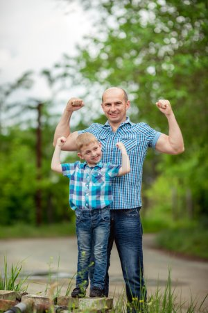 Young happy father with son