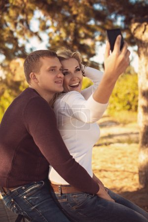 Couple take pictures of themselves