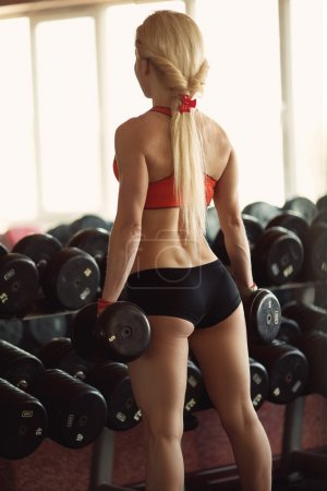 Sexy woman on sport gym club
