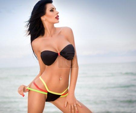 Bikini girl posing at beach
