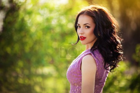 woman in violet dress outdoors