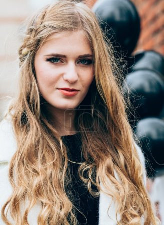 Photo for Beautiful stylish girl in trendy clothes on street with black balloons - Royalty Free Image