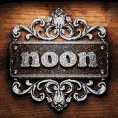 Noon vector metal word on wood