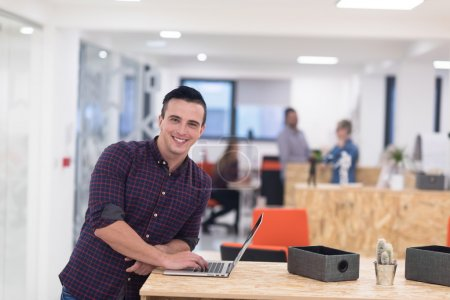 startup business, young  man portrait at modern office