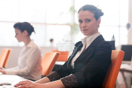 business woman at  office people group in background