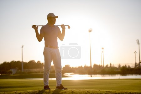 golfer  portrait at golf course on sunset