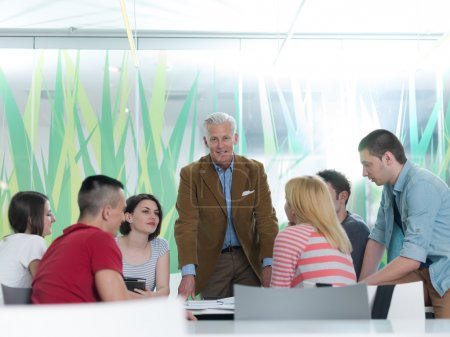 portrait of in teacher in classroom with students