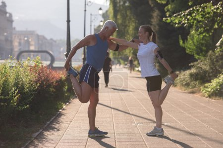 couple warming up and stretching before jogging