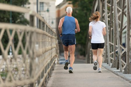 healthy mature couple jogging