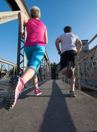 healthy mature couple jogging