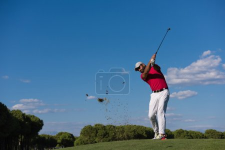 golf player hitting long shot