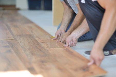 Men Installing laminate floor