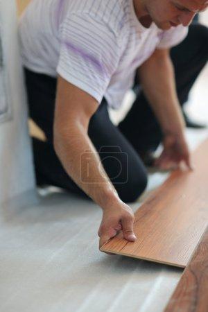 Men Installing laminate flooring