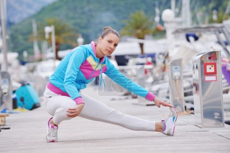 Woman stretching in marina