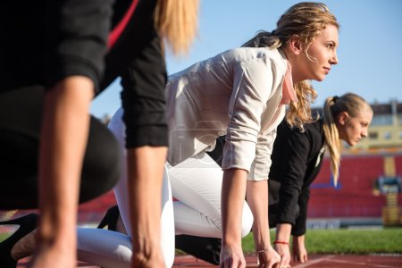 Business women on racing track