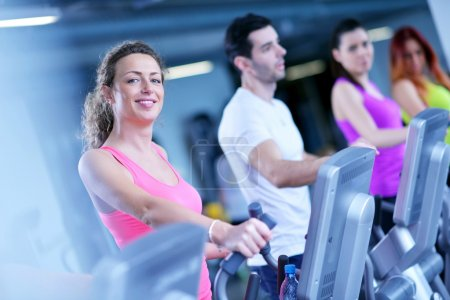Group of people working out at gym