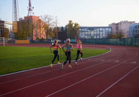 women group  running on athletics race track