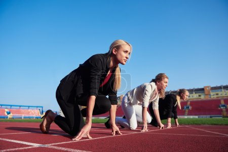 Business people running on racing track
