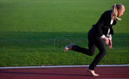 Businesswoman ready to sprint