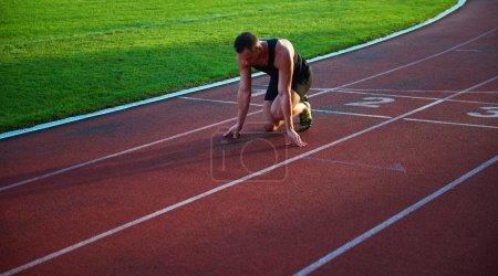 Athletic man at starting blocks
