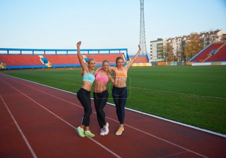 Athletic women on race track