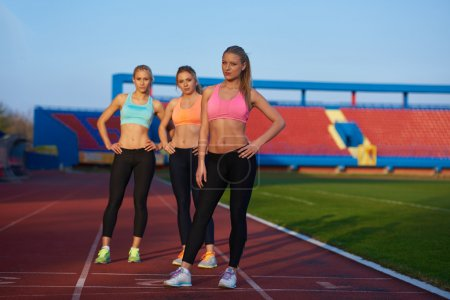 Athletic women on athletics race track