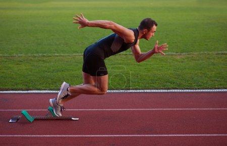 Athletic man at running track.