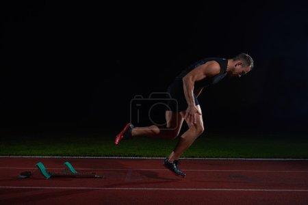 Sprinter leaving starting blocks