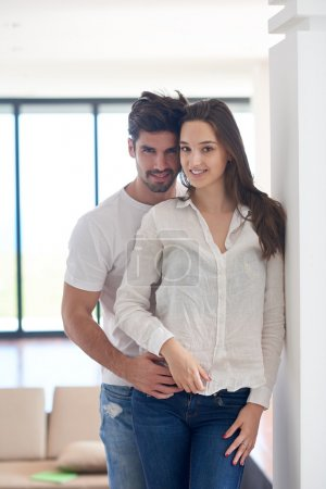 Happy young romantic couple at home
