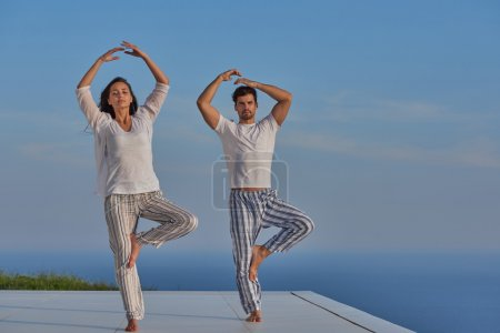 young couple practicing yoga