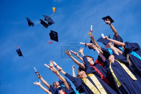 High school students tossing up hats