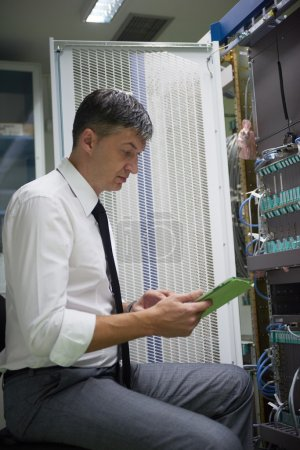 network engineer working in  server room