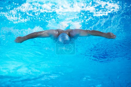 Swimmer in indoor swimming pool