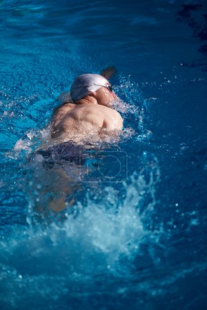 swimmer excercise in indoor pool,