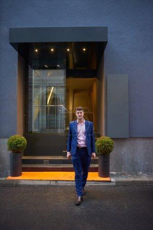 business man entering  hotel