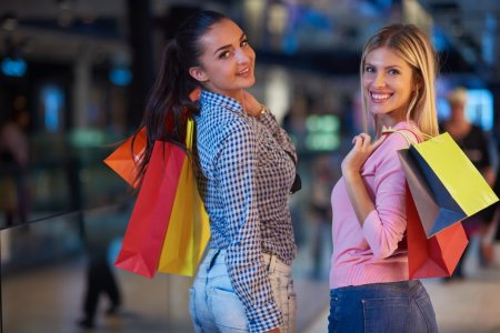 happy young girls in  shopping mall