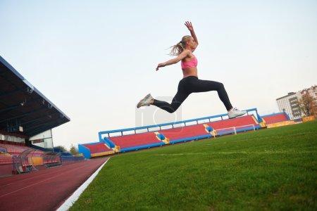 Athletic woman running