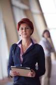 business woman  at office with tablet  in front  as team leader