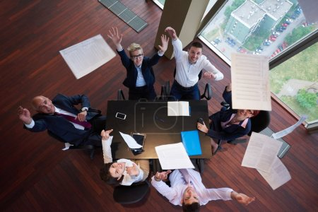 top view of business people group throwing dociments in air
