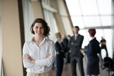 Business people group, woman in front  as team leader