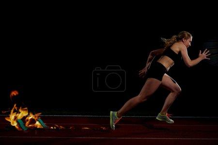 pixelated design of woman  sprinter leaving starting blocks