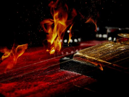double exposure  electric guitar and fire