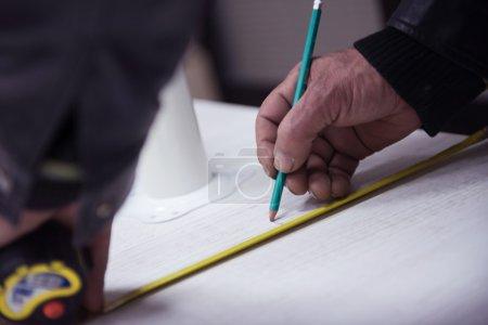 carpenter worker measuring