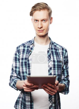 Photo for Happy Young Man Using Digital Tablet Isolated On White Background - Royalty Free Image